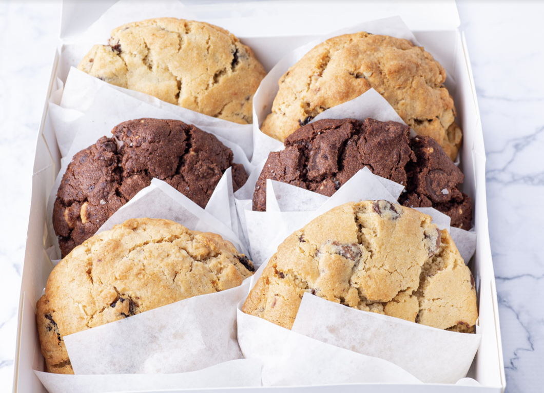 a box filled with different cookies