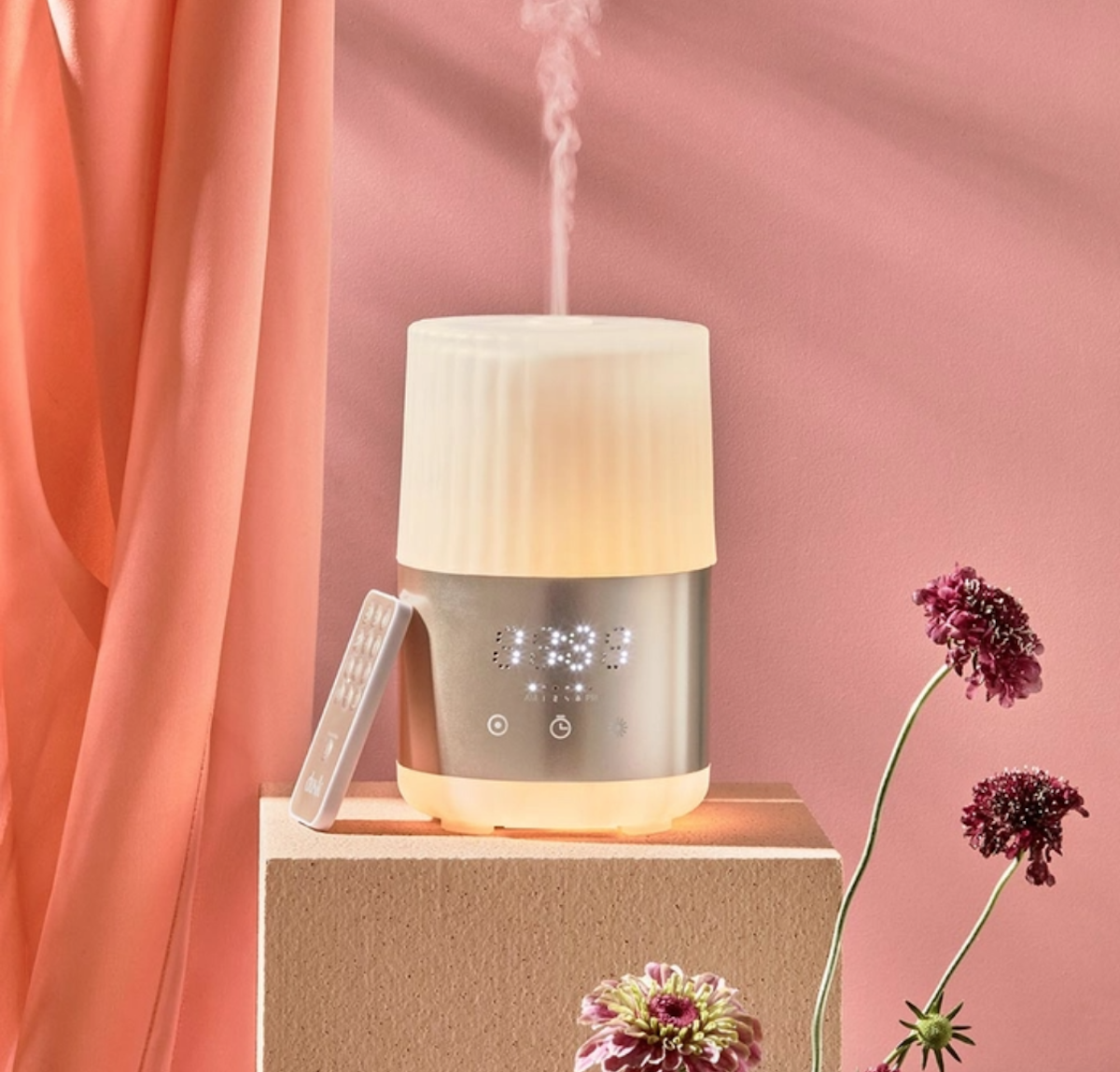 Essential Oil Diffuser Alarm Clock sitting on a bench