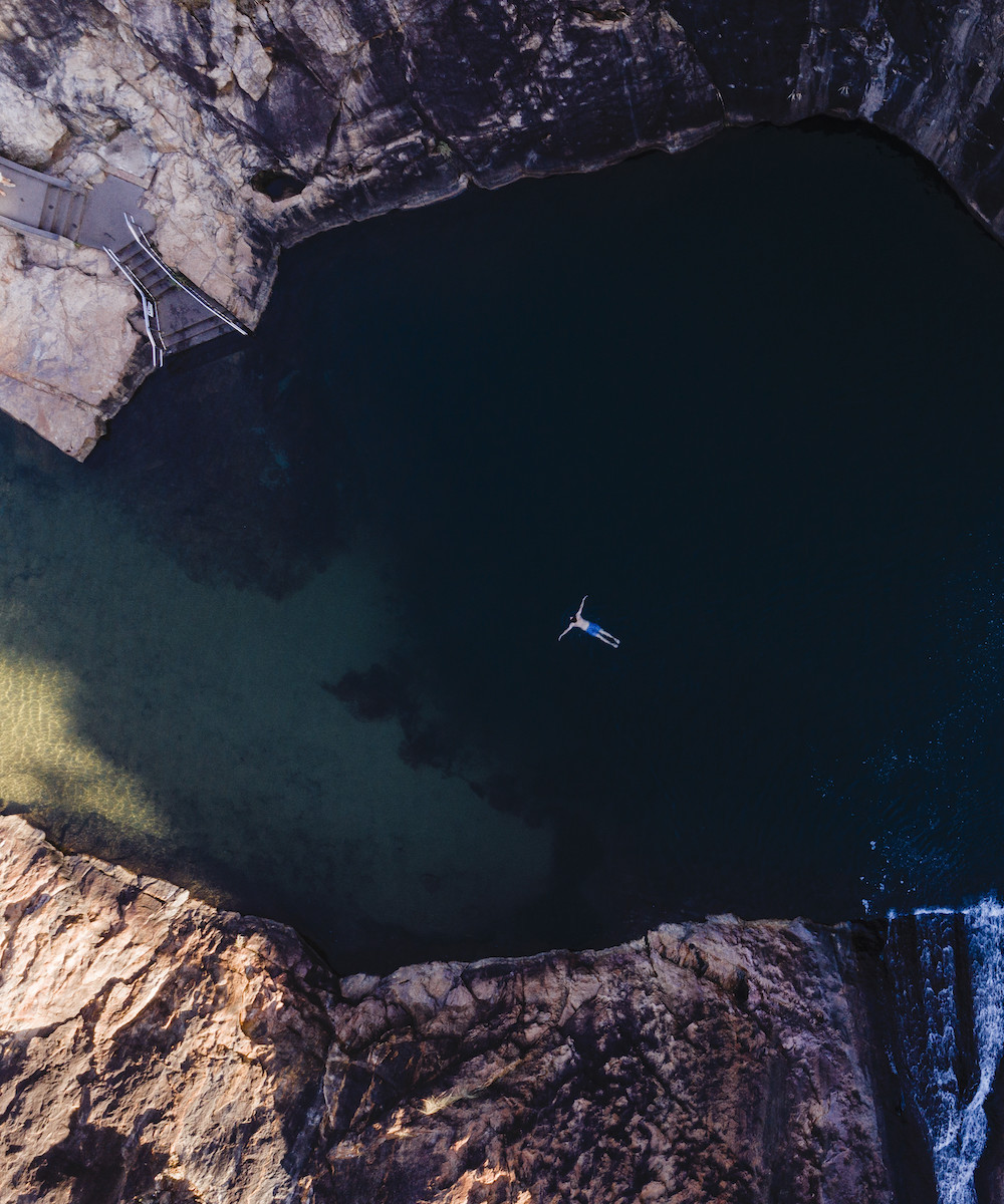 Person swimming in Serpentines Fall