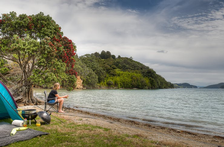 A person looks out at the water at Shelly Beach camp grounds.