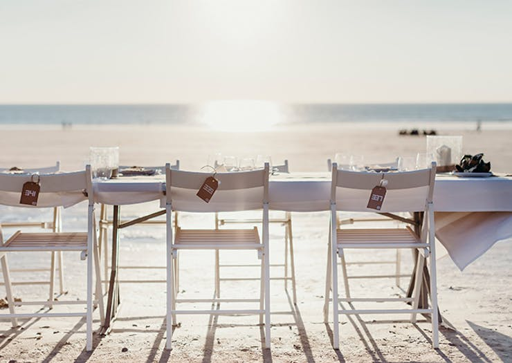 A Stunning Sunset Supper Is Coming To One Of Australia's Most Beautiful Beaches