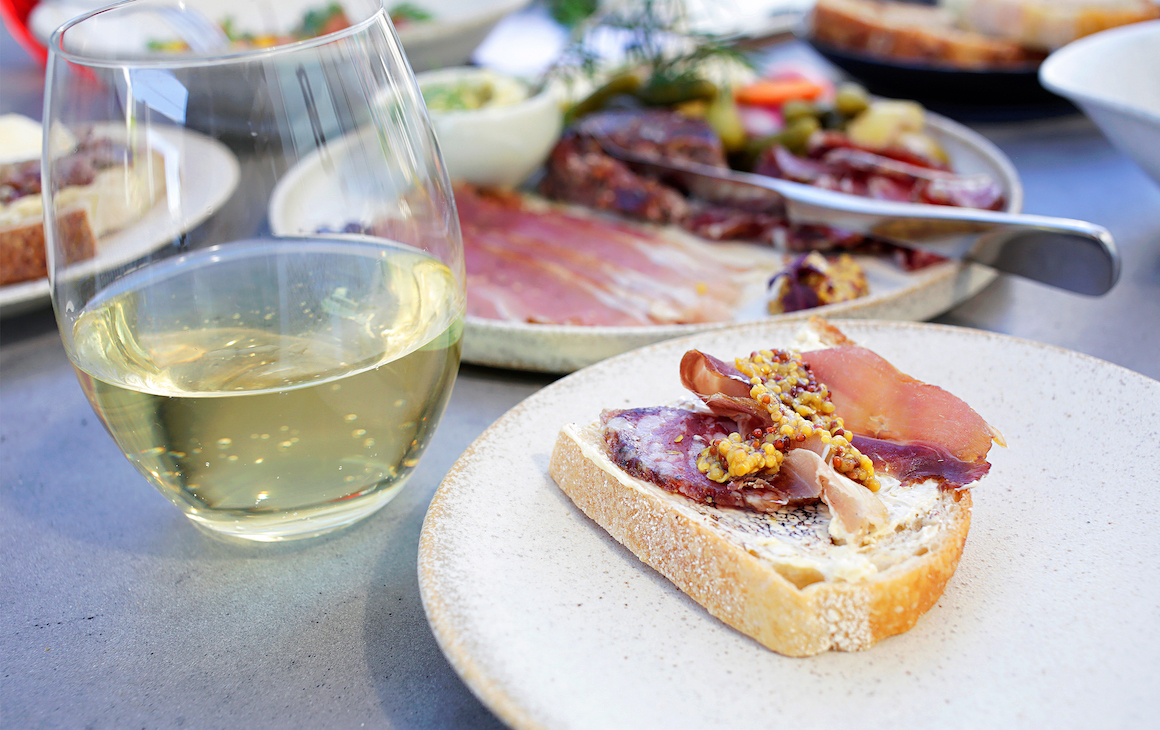 A white wine and nibbles from Skol