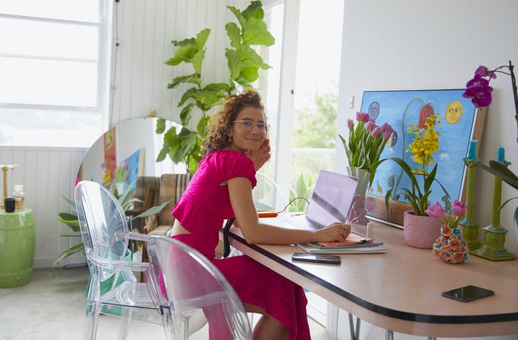 Sophia Athas sits at her desk in her home office.