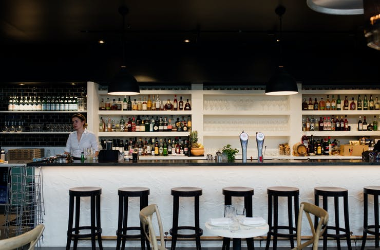 a sleek, dark bar at a restaurant