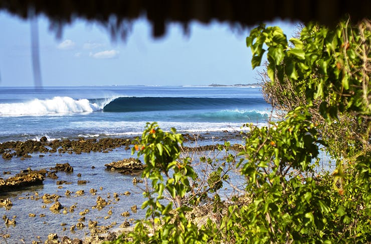 A photo from the resort of a wave peeling down down the reef.