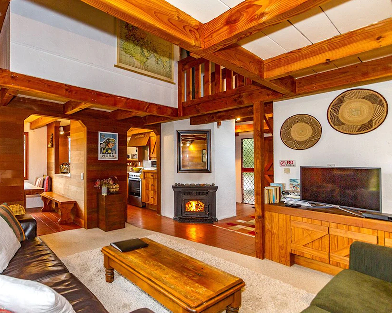 The interior of the Swiss Chalet shows a roaring log fire and warm wooden accents.