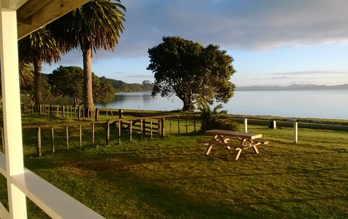 View from Te Kuiti House—Umupuia beach with view of foggy mountains afar.