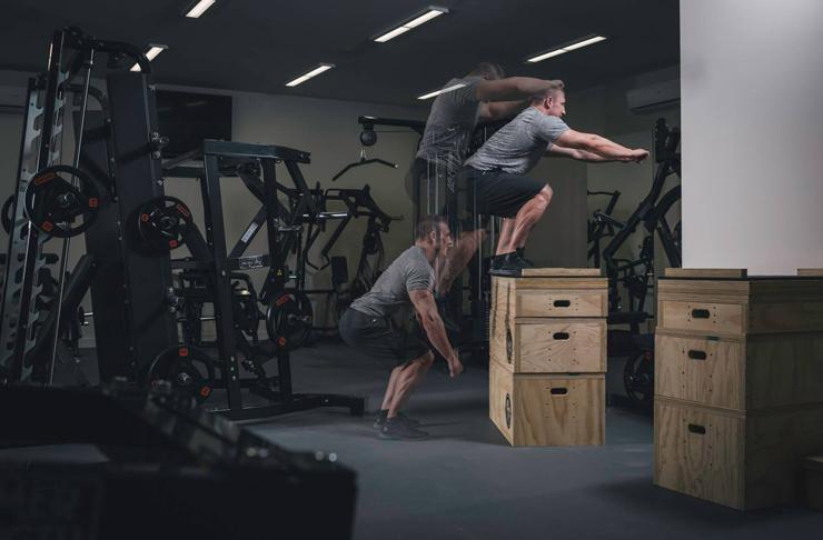A man attempts a box jump