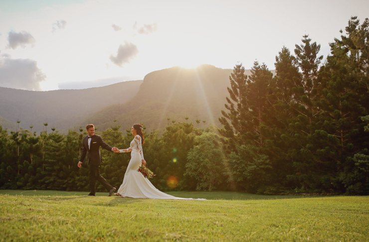 A bride and groom stroll the countryside at Bower Estate on the Gold Coast.