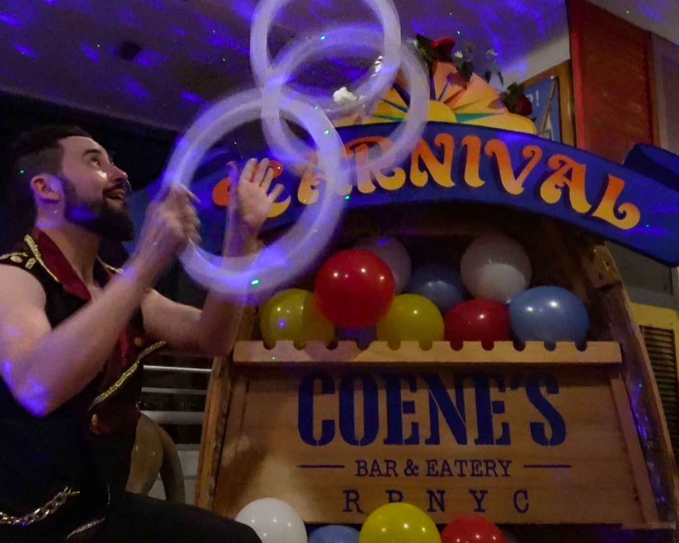 A person juggling hoops in a carnival