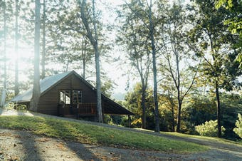 A timber A-frame sits on a farm in the Noosa Hinterland.