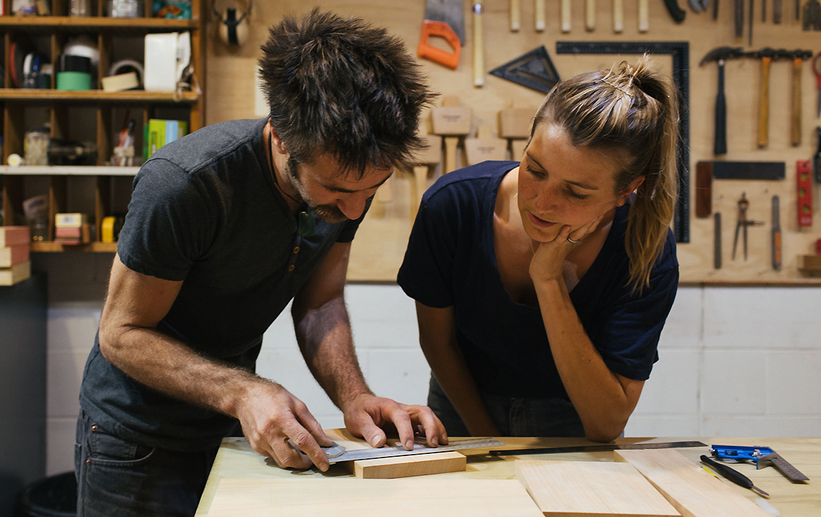 Two people look at a woodworking problem at one of Auckland's best classes, The Warren.
