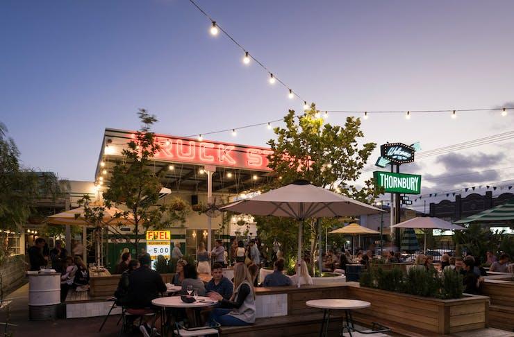 an outdoor restaurant with fairy lights