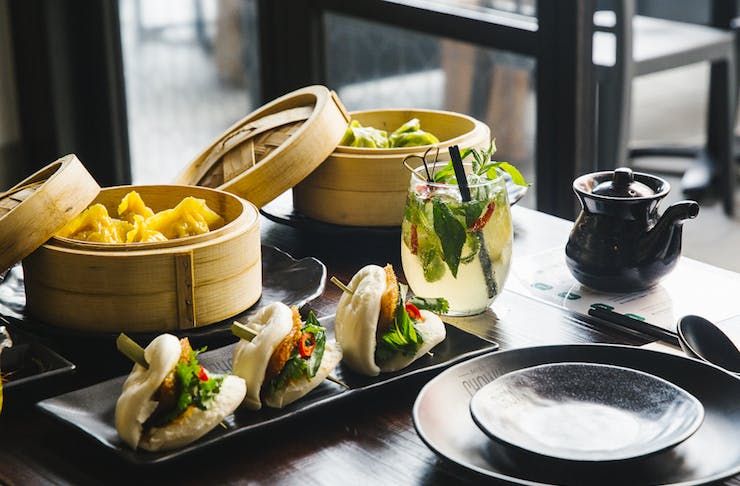 A table filled with bao and dumplings at Miss Chows