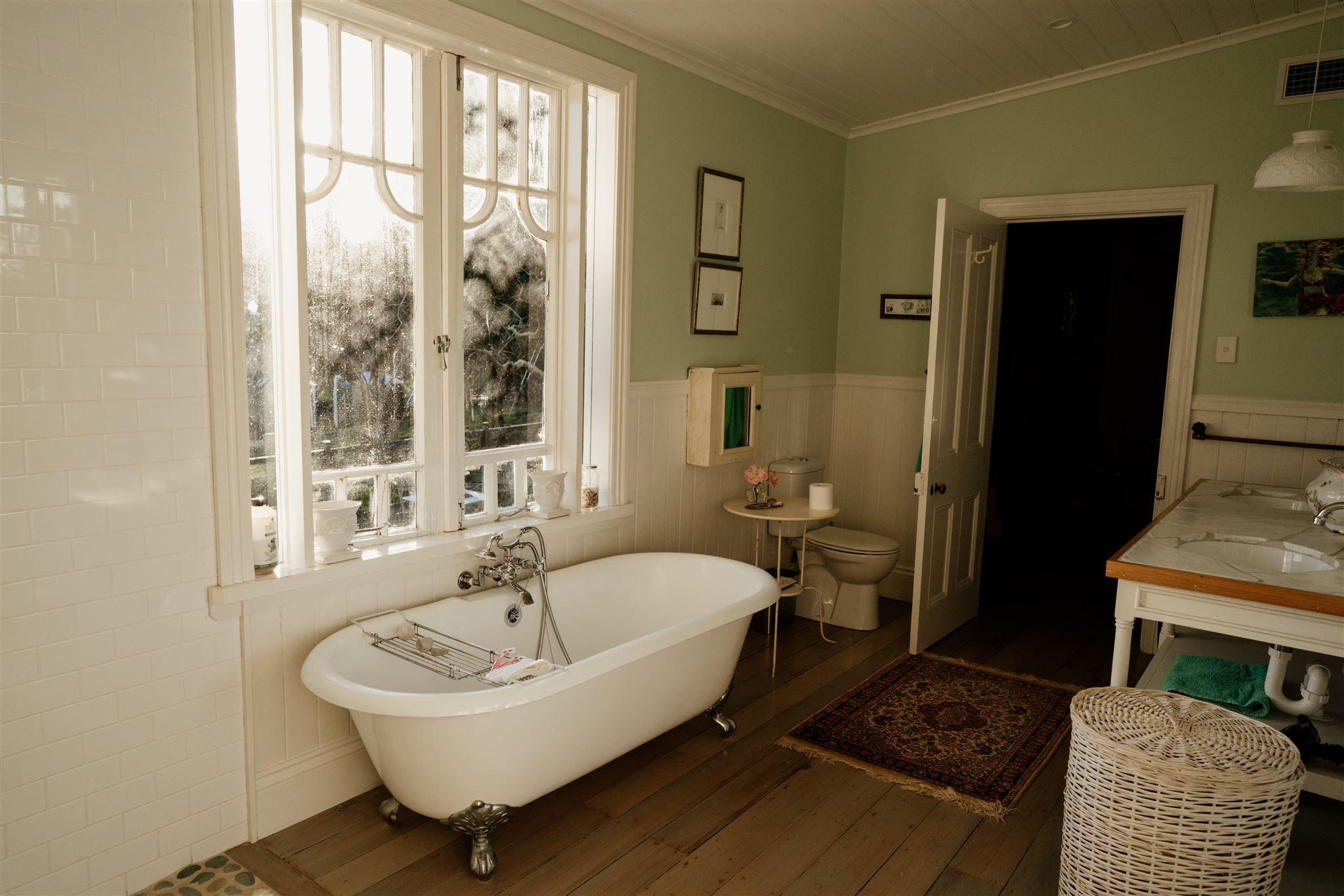a clawed bathtub in an old fashioned bathtub