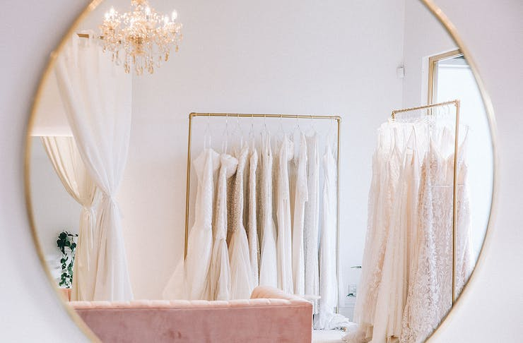 Dresses reflected in a golden gilt mirror at the beautiful showroom at Trish Peng in Ponsonby.