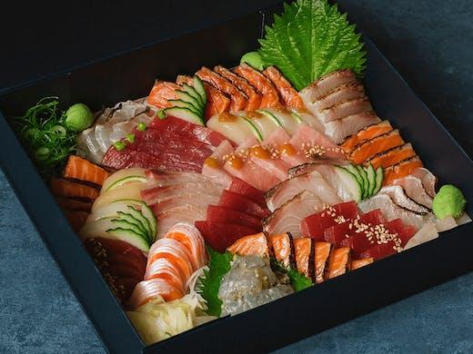 a box of colourful sashimi sushi