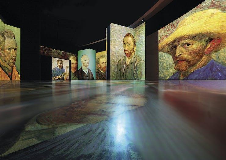 Self portraits of Vincent Van Gogh adorn the walls.