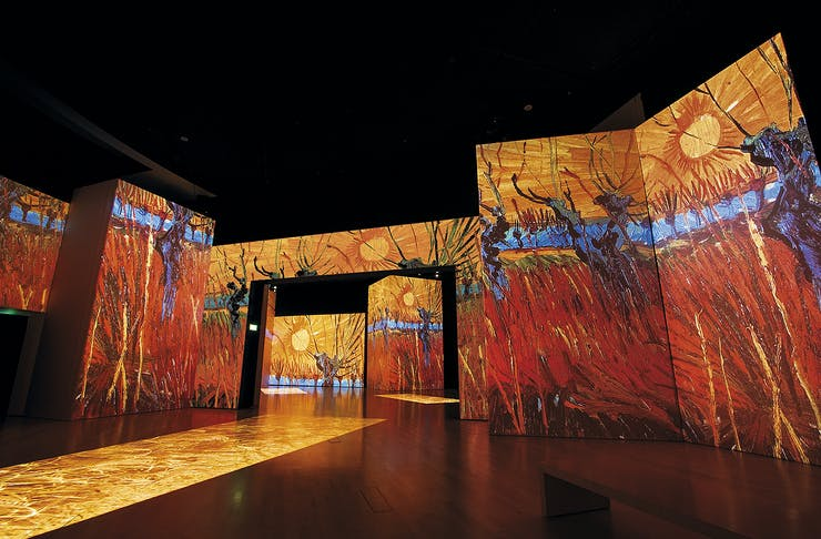 The Red Vineyard is projected onto a wall.