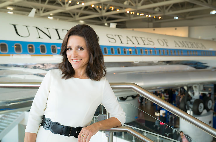 Julia Louis-Dreyfus as Vice President Selina Meyer, standing in front of Air Force Two in HBO's Veep