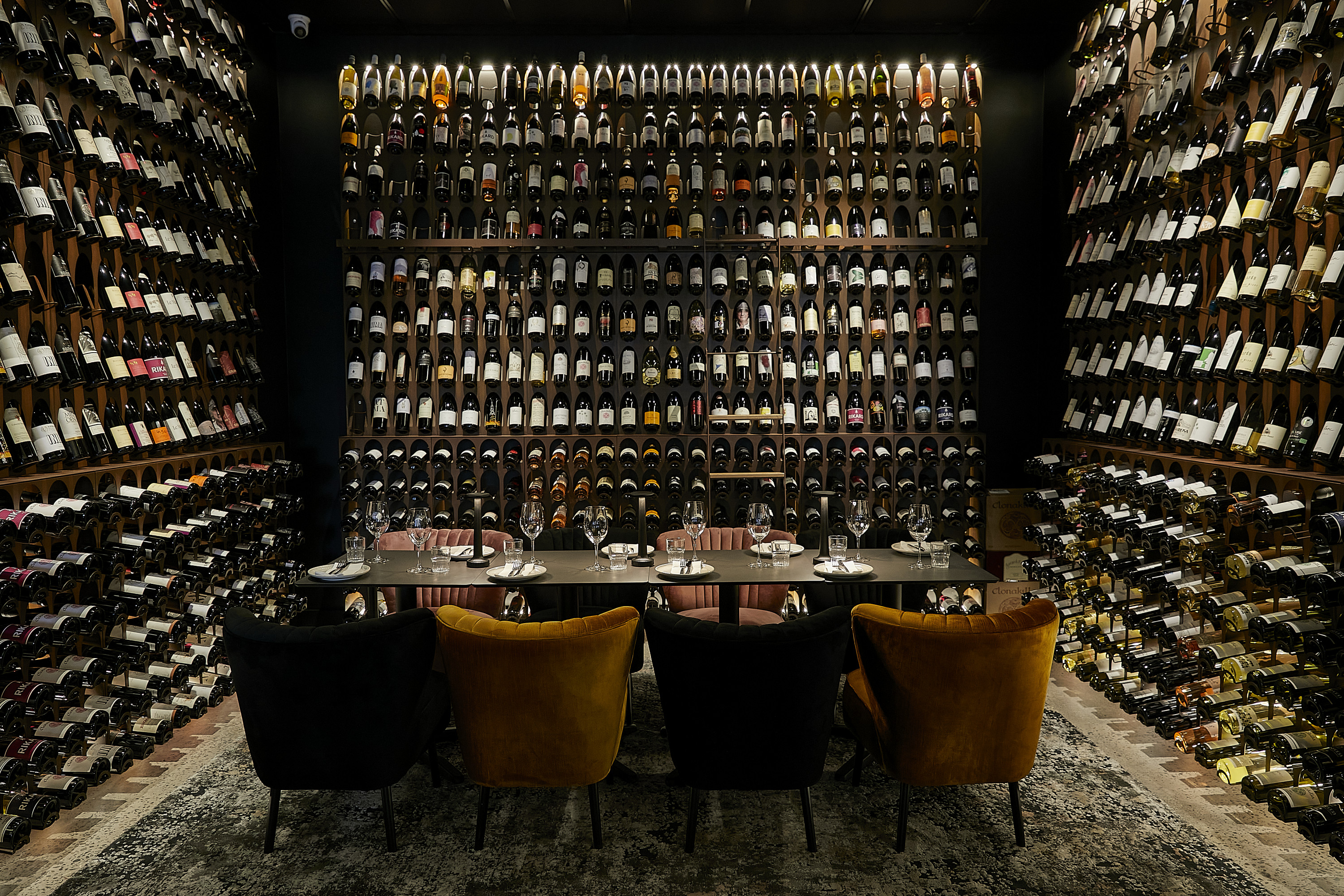 a wall stacked with wine bottles