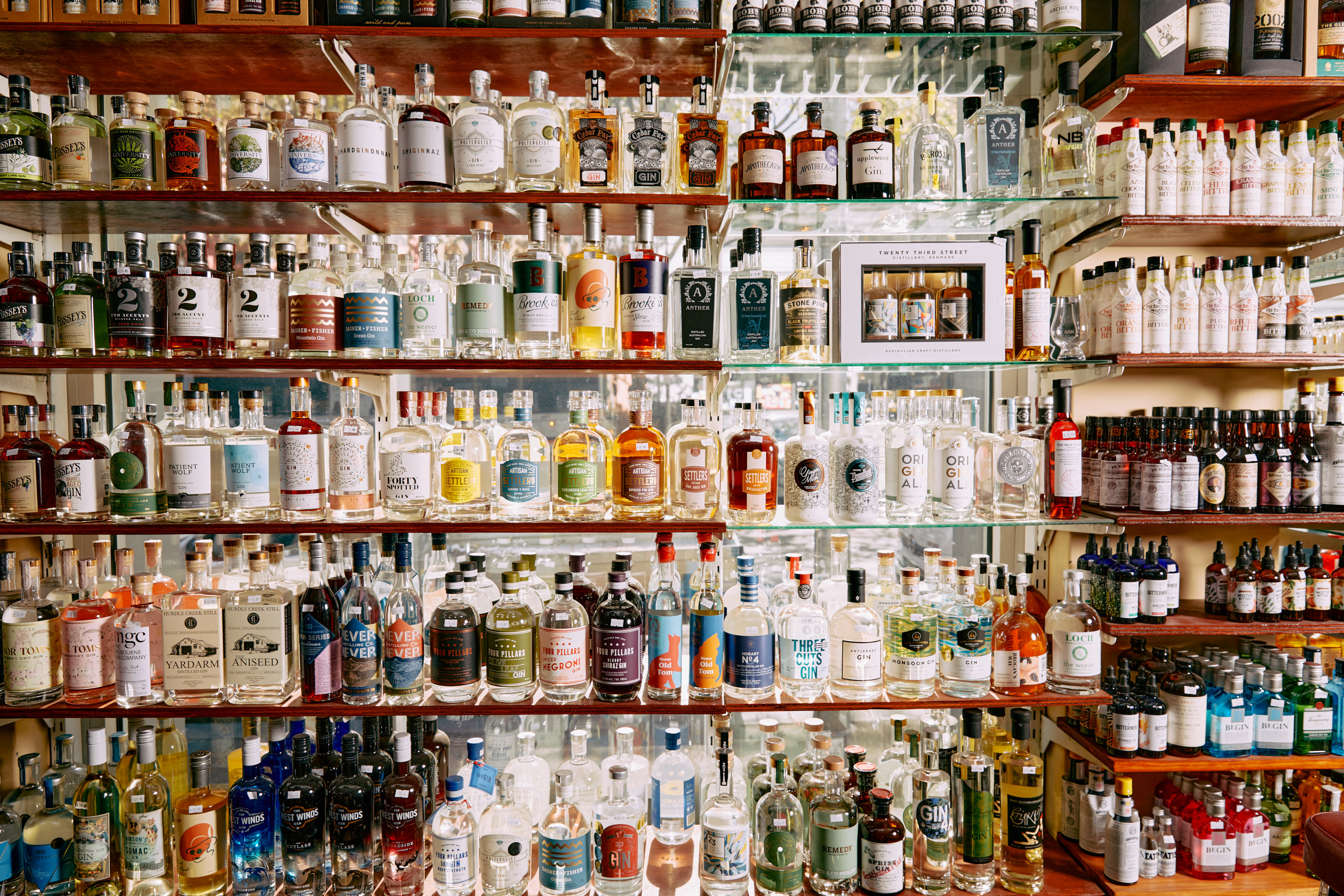 Several shelves stacked with fine liquor