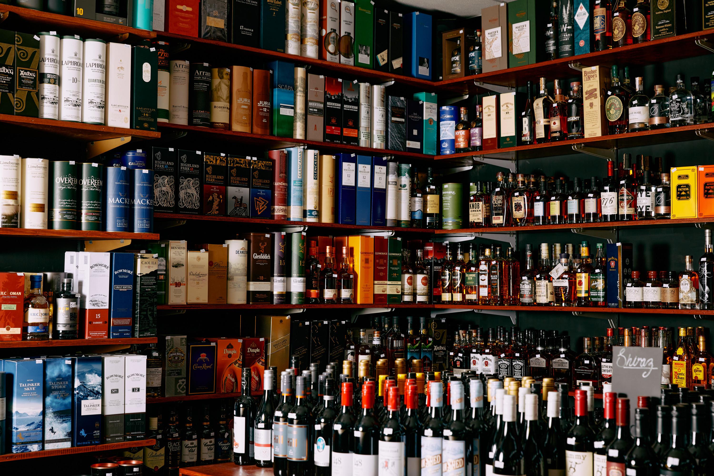 A shelf full of fine liquor.