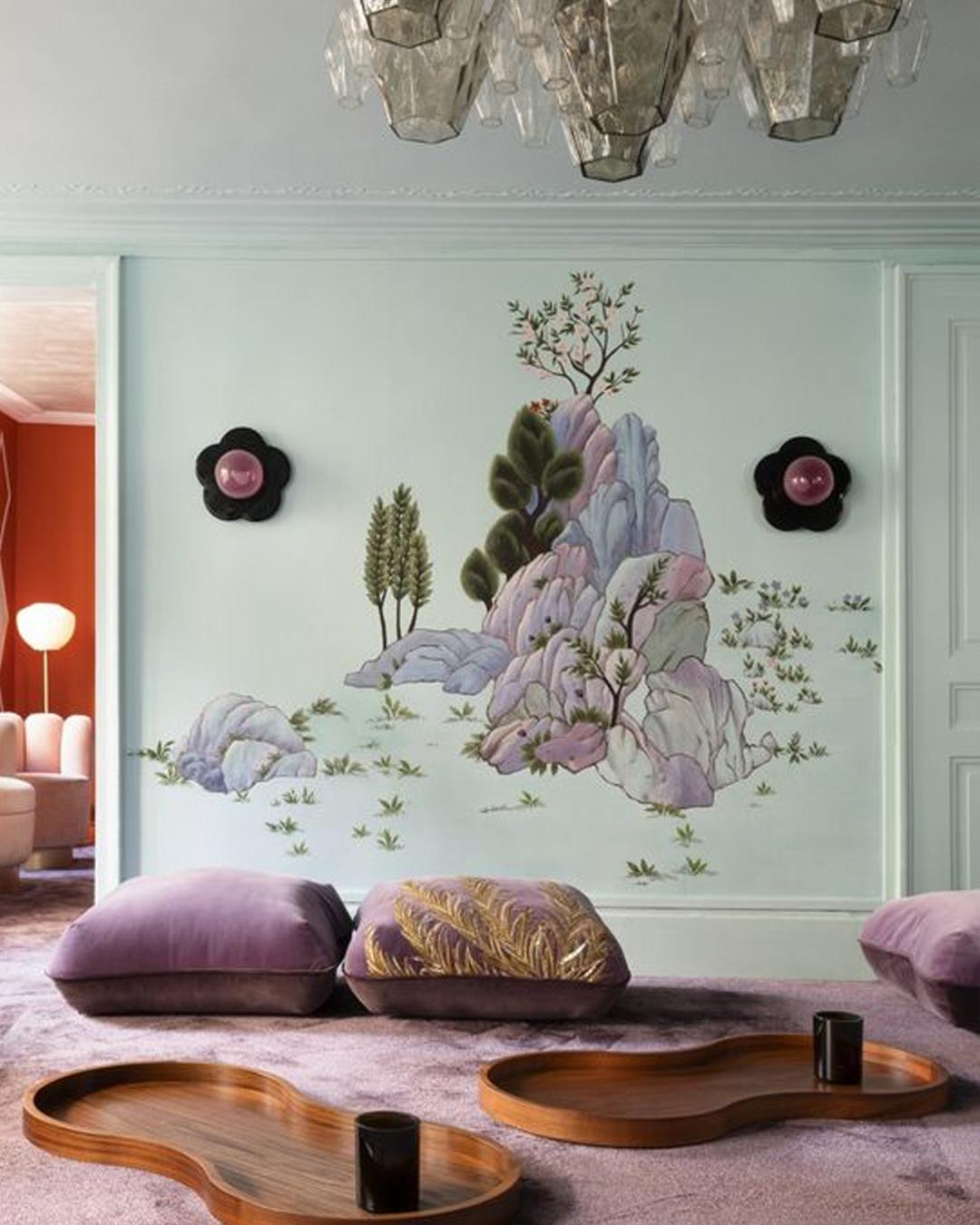 de Gournay mural wallpaper against a mint green wall.