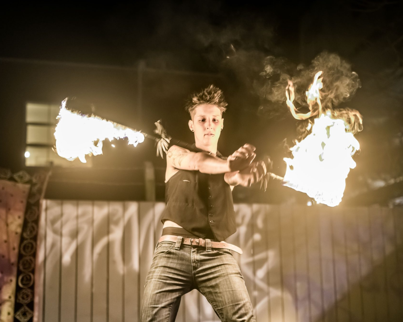 A person performing an act with fire