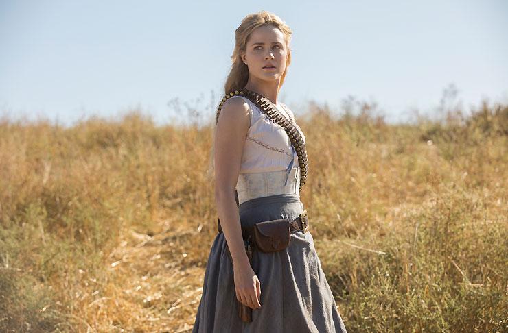 Evan Rachel-Wood as Dolores Abernathy standing in a dry field in HBO's Westworld