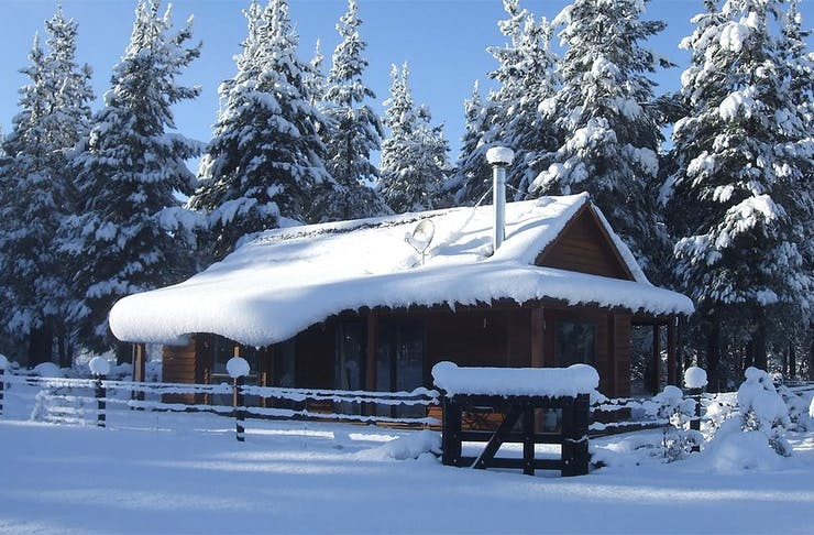 The snow-topped cabin at Woodbank Park Cottages looking fiercely cold, but cosy.