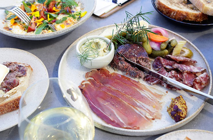 SKØL, a table topped with share plates of food