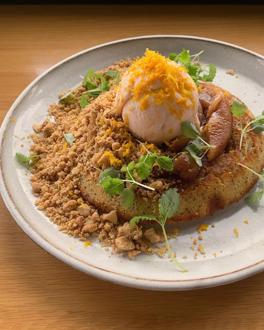 a pancake topped with ice cream and crumble