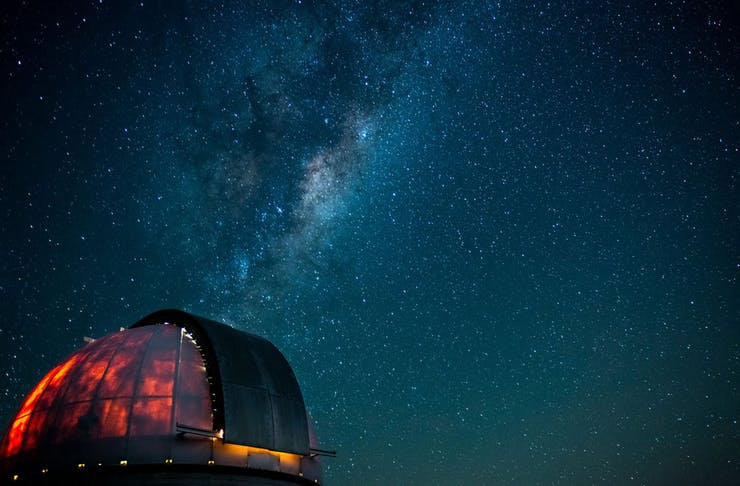 A starry night observed behind the Mount Burnett Observatory.