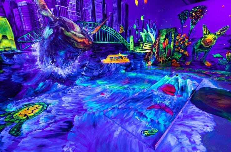 A bright and colourful glow in the dark putt putt room.