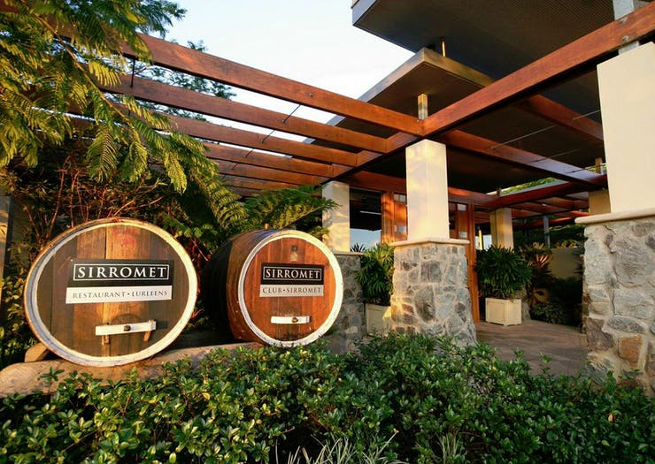 Wine barrels sit at the front of Sirromet Winery.