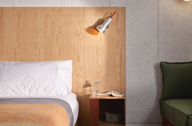 A bed and side table at Ace Hotel Sydney