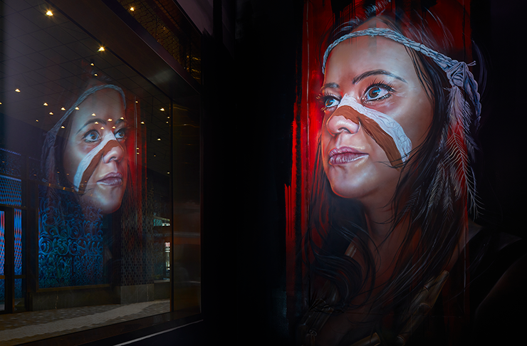 A mural featuring several indigenous people by artist Adnate.