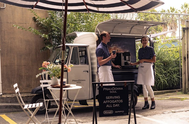 The affogato truck with two people waiting to serve you coffee.
