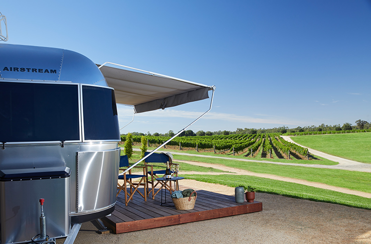 An airstream overlooking a winery.
