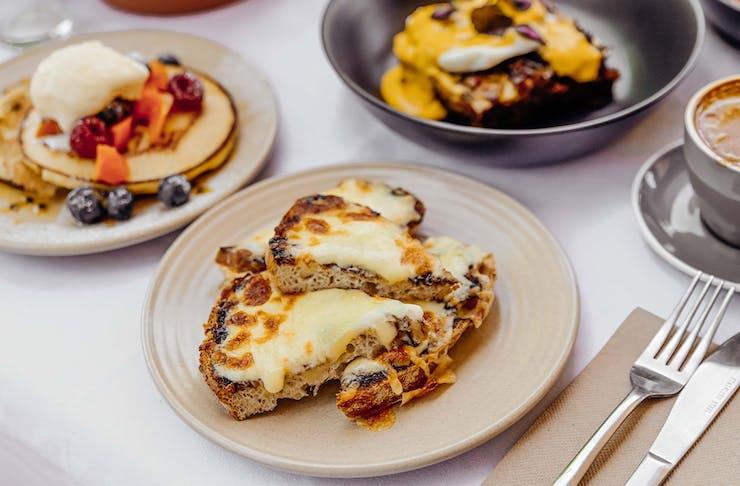 a cheesy toast dish at ant and ola