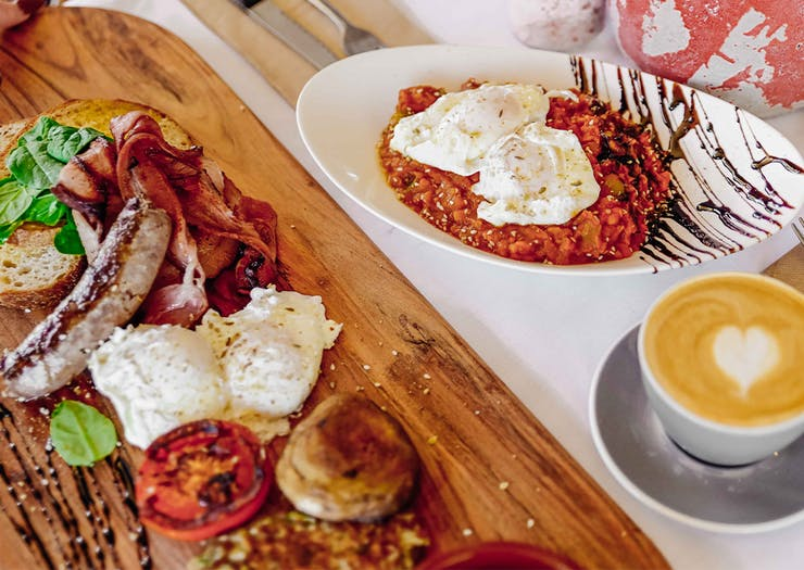 spread of breakfast dishes at ant and ola