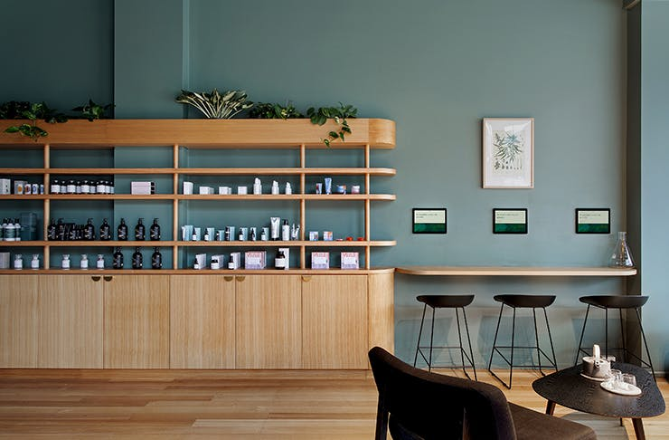 A green and oak covered interior of Australia's first female-led cannabis dispensary.