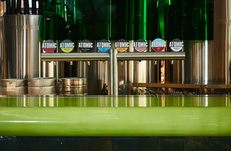 The lime green resin bar at Atomic Beer Project in Redfern, Sydney.
