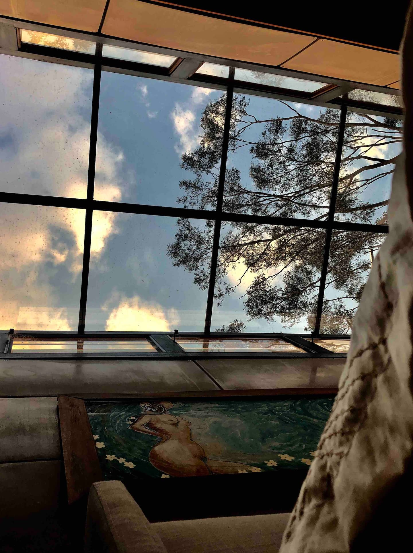 view above a bed to a glass roof