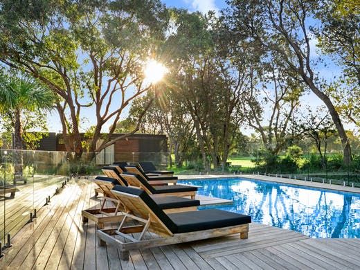 The pool at Shoalhaven Heads' luxury beachside retreat, Bangalay Villas.
