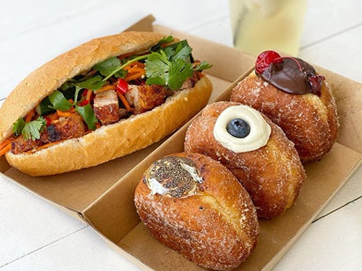 a banh mi and doughnuts in a box