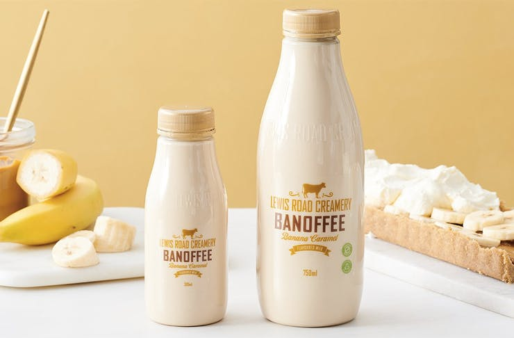 Lewis Road Creamery's new Banoffee flavoured milk with banana and caramel in the background.