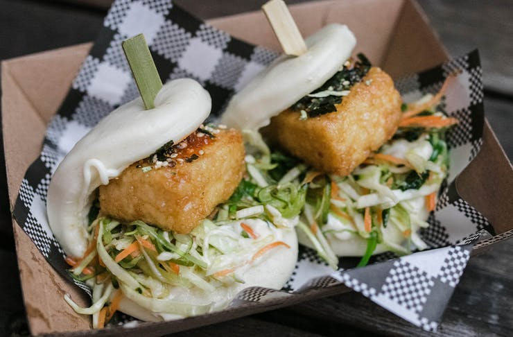 Two tofu bao in a takeaway box