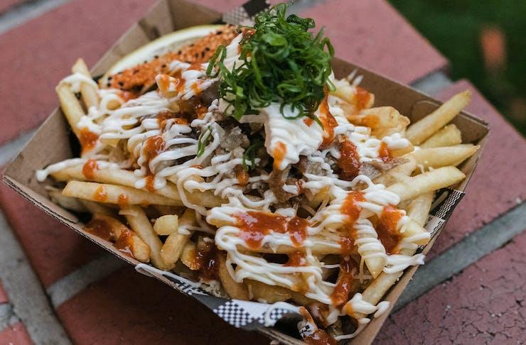 loaded fries in a takeaway box